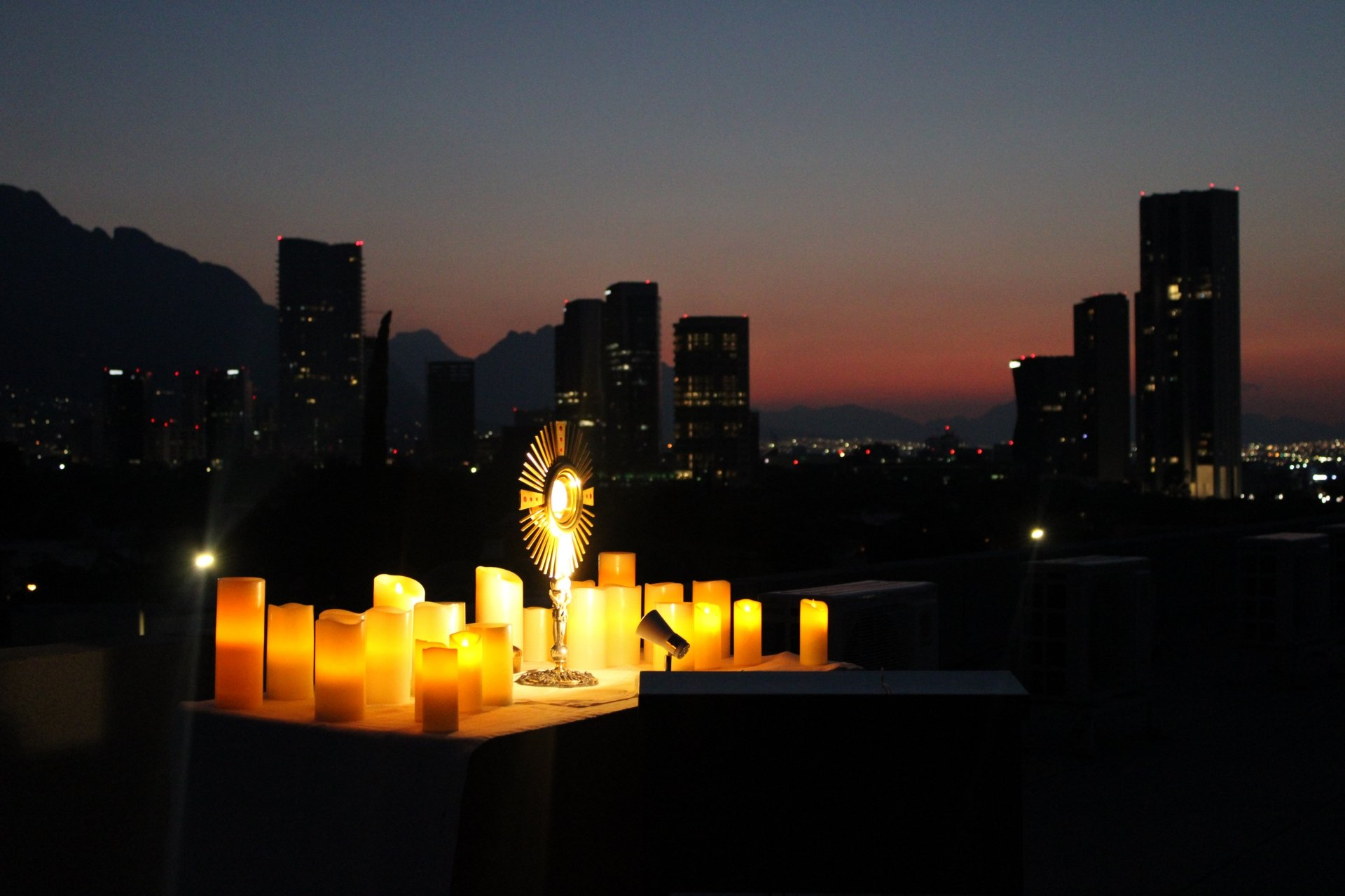 eucharist, sky, clouds, candles, city, sunset, hope, god, worship, christ, darkness