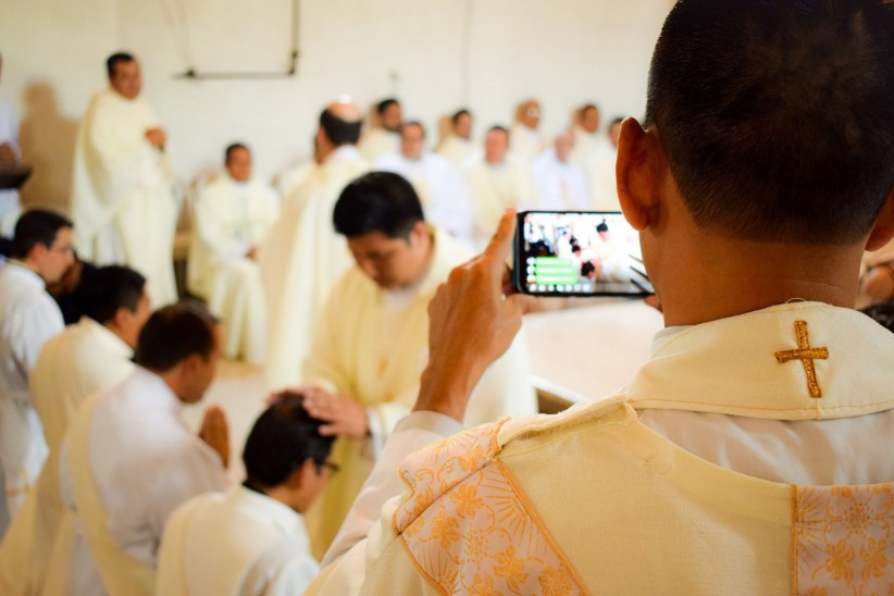 Eucharist, hands, priests, ordering, parents, imposition, cell phone, technology